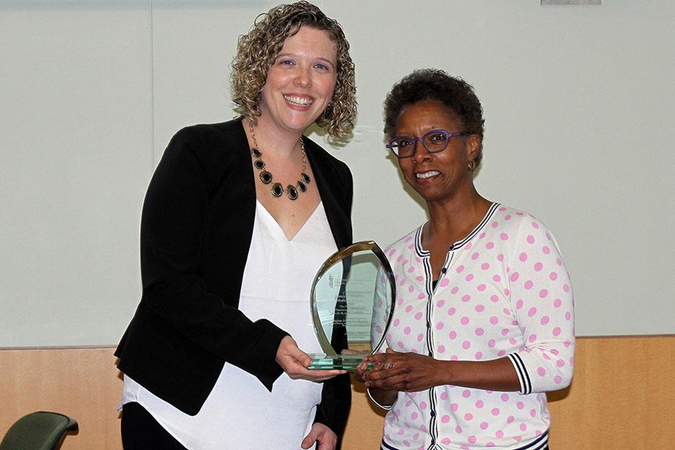 Dr. Meghan Swarthout poses for photo with Dean Natalie D. Eddington.