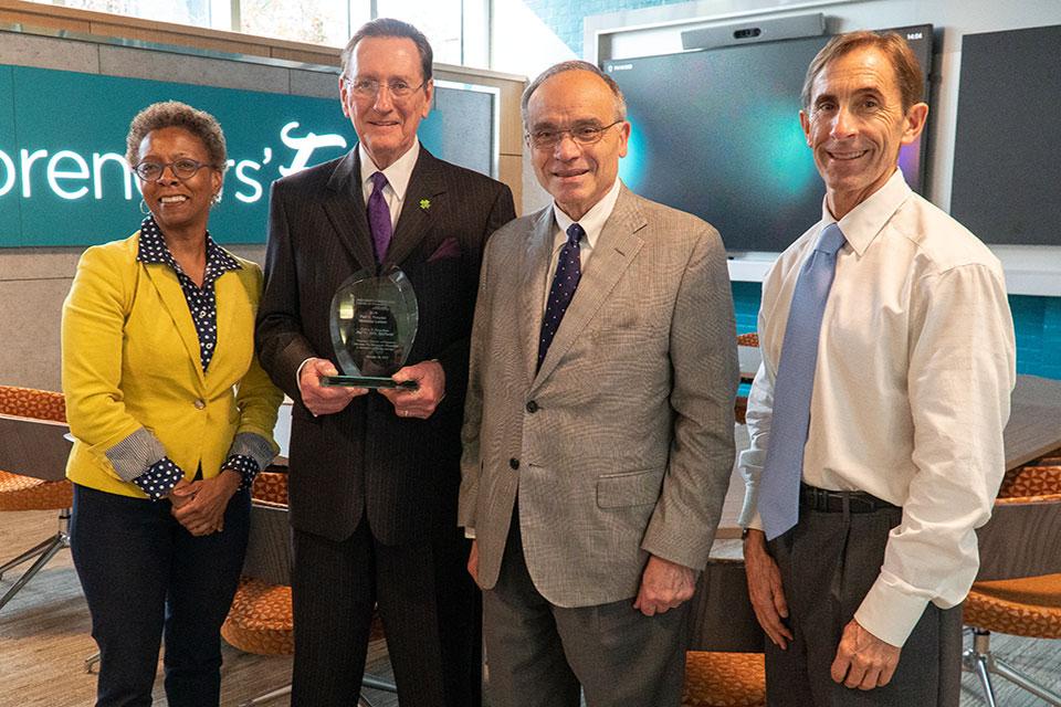 Dr. Calvin Knowlton poses for photo with Drs. Natalie Eddington, Frank Palumbo, and C. Daniel Mullins.